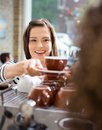Customer Taking Coffee From Waitress In Cafe Royalty Free Stock Photos - 35729788