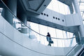 Distant Businessman Walking In A Modern Office Building Stock Photos - 35754863