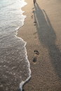 Footprints On The Beach And Shadow Royalty Free Stock Photography - 35755117