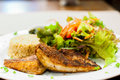 Fried Fish Steak With Salad And Fried Rice Royalty Free Stock Image - 35769976