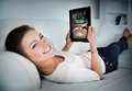 Happy Woman Lying On Couch And Gambling On Tablet Royalty Free Stock Image - 35777016