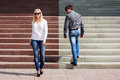Young Fashion Man And Woman Flirting On The Steps Royalty Free Stock Photo - 35779665