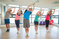 Fitness Class And Instructor Standing In Namaste Position Royalty Free Stock Photos - 35789798