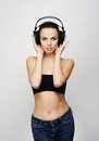 A Young And Fit Teenage Girl Listening To Music In Headphones Stock Images - 35805074