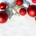 Red Christmas Bulbs And Star In White Snow Border Stock Photography - 35878672