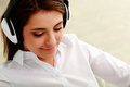 Young Beautiful Businesswoman Listening Music In Headphones Stock Photo - 35887190