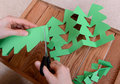 Cutting Green Card Into A Chain Of Christmas Trees Royalty Free Stock Photography - 35899117