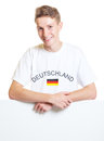 German Sports Fan Standing On A Sign Board Stock Photography - 35902852