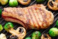 Grilled Pork Chop With Brussels Sprouts Stock Photography - 35904912