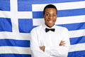 Portrait Of Happy Man With Arms Crossed Against Greek Flag Royalty Free Stock Photos - 35924258