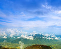 Landscape With Clouds, Mountains, Blue Sky And Village. Carpathi Stock Photo - 35933220
