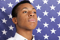Close-up Of Young Man Against American Flag Royalty Free Stock Photos - 35935038