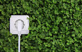 Electric Power Receptacle On A Green Grass Background Stock Image - 35951971