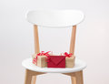 Gifts And Red Envelope On A Wooden Chair Stock Image - 35973741