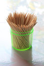 Toothpicks In Transparent Plastic Cylinder Royalty Free Stock Photo - 36027135
