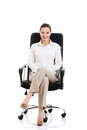 Beautiful Young Business Woman Sitting On A Chair. Stock Photos - 36028403
