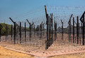 Wire Mesh And Barbed Wire. Royalty Free Stock Photography - 36030387