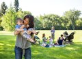 Young Woman Carrying Baby Boy In Park Royalty Free Stock Photos - 36035758