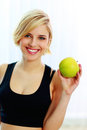 Happy Smiling Fit Woman Holding Green Apple Royalty Free Stock Images - 36062289