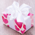 Pretty Valentines Gift With Hearts On The Giftwrap Royalty Free Stock Photography - 36066727