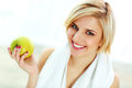 Happy Smiling Fit Woman Holding Green Apple Royalty Free Stock Image - 36109066