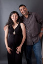 Happy East Indian Husband With His Pregnant Wife Royalty Free Stock Photography - 36125657