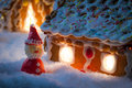Marzipan Santa Near Gingerbread Cottage Royalty Free Stock Images - 36128309