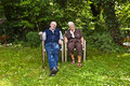 Elderly Couple Sitting Hand In Hand Royalty Free Stock Image - 36133226