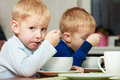 Boys Kids Children Eating Corn Flakes Breakfast Meal At The Table Royalty Free Stock Photo - 36185035
