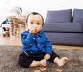 Asian Baby Boy Eating Candy Stock Photo - 36192670