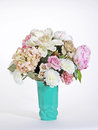 Pink And White Flowers In A Turquoise Green Deco Vase Stock Photos - 36213643