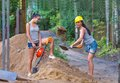 Pretty Young Woman Builder Digging A Shovel Royalty Free Stock Images - 36227829