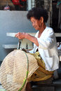 Thai Old Woman Weaving Bamboo Baskets Stock Photography - 36235372