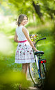 Beautiful Girl Wearing A Nice White Dress Having Fun In Park With Bicycle. Healthy Outdoor Lifestyle Concept. Vintage Scenery Royalty Free Stock Photography - 36236257