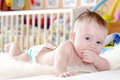 Baby In Diaper Lying Against White Bed Stock Images - 36253874