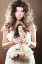 Young Woman With Doll Royalty Free Stock Photos - 36268208