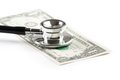 Stethoscope On One Dollar, Cost Of Medical Health Care Royalty Free Stock Image - 36304146