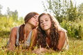 Two Girlfriends Lying Down On Grass Stock Image - 36328061