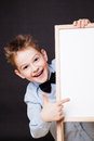Portrait Of Cheerful Boy Pointing On White Banner Stock Photography - 36368832
