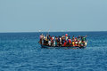 In Ocean Floats Your Boat With Large Group Of Africans. Stock Image - 36368851