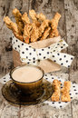 Garlic Cheese Bread Sticks And Cup Of Black Tea With Milk Stock Photo - 36381460