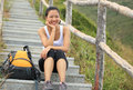 Woman Hiker Sit On Mountain Stairs Royalty Free Stock Photo - 36425425