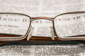 Glasses On Newspaper Royalty Free Stock Photo - 36430115