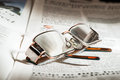 Glasses On Newspaper Stock Images - 36430154