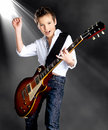 Boy Playing On Electric Guitar On The Stage Royalty Free Stock Photography - 36431447