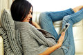 Young Beautiful Woman Resting On A Sofa With Tablet Computer Stock Images - 36458164