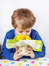 Cute Lovely Toddler Boy Of 3 Years Sniffing Yellow Flowers For M Stock Photos - 36464173