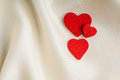 Red Wooden Decorative Hearts On White Silk Background. Stock Image - 36512651