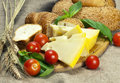 Bread, Cherry Tomatoes, Cheese And Basil On Wooden Cutting Board Royalty Free Stock Photo - 36537495