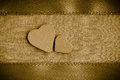 Valentine Wooden Decorative Hearts On Golden Cloth Background Royalty Free Stock Images - 36542819